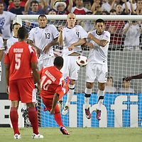 USA midfielder Landon Donovan (10), USA midfielder Jermaine Jones (13), USA midfielder Michael Bradley (4), and USA midfielder Clint Dempsey (8) defend a kick from Panama midfielder Nelson Barahona (10) during a  CONCACAF Gold Cup soccer match between the United States and Panama on Saturday, June 11, 2011, at Raymond James Stadium in Tampa, Fla. (AP Photo/Alex Menendez)
