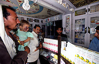 KABUL 04 August 2005..PHARMACY....Janat Ghul with his daughter in the pharmacy...He buys the medicines prescribed by Dr. Parwani: vitamins, pain killers and antibiotics. ..Dr Parwani is the dermatologist who has visited  Shabana at Khair-Khana clinic. He is also the head of dermatology at Avencina Emergency Hospital ..