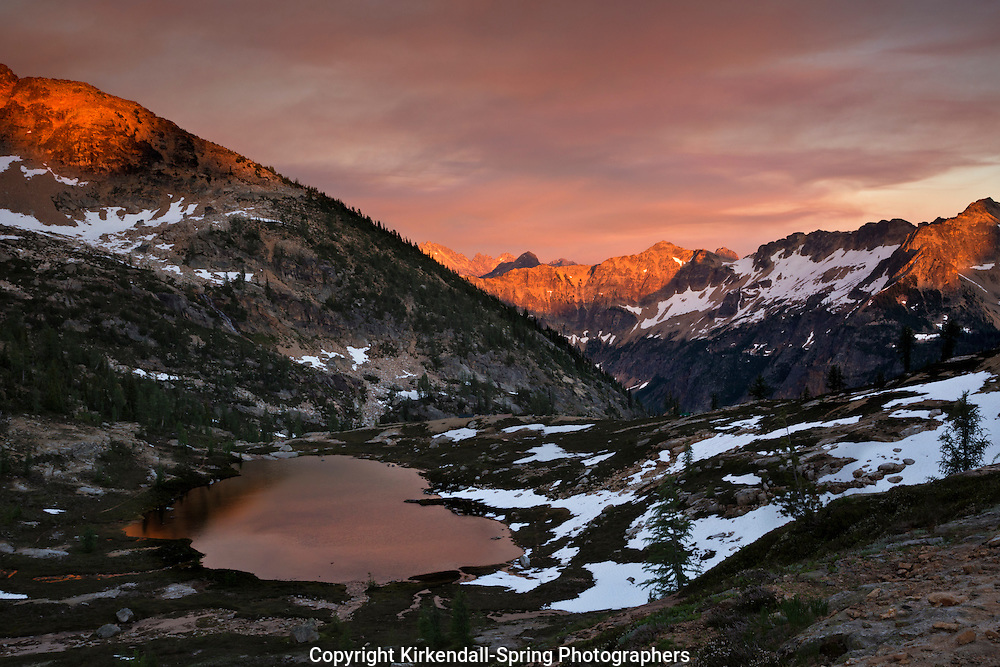 WA10506-00...WASHINGTON - Sunset at Snowy Lakes Basin in the North Cascades section of Okanogan National Forest. (The clouds and the color are the products of smoke from several forest fires).