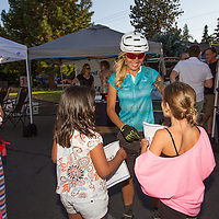 Carolynn Romaine (Pivot Cycles) gladly signs autographs.  © Brian Nelson