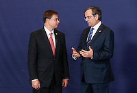 Latvian Prime Minister Valdis Dombrovskis(L) and Greek Prime Minister Antonis Samaras talk together during a family photo during an European Union summit in Brussels, Belgium, 24 October 2013.