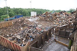 Piles of heavy melting scrap (HMS) steel in skips at a metal recycling centre,