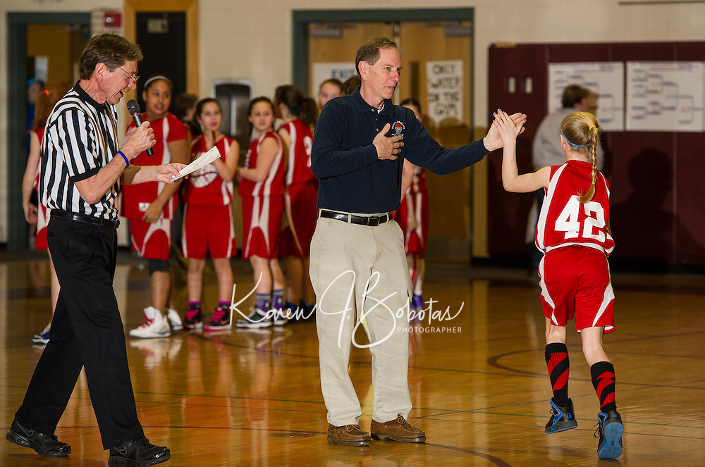 Jim Babcock and Thom Francoeur introduce the girls senior division team from Laconia to the championship round game against Belmont during the 22nd annual Francoeur Babcock Memorial Basketball Tournament on Sunday morning at Gilford Middle School.  (Karen Bobotas/for the Laconia Daily Sun)