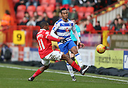 Charlton Athletic midfielder Callum Harriott (11) and Reading midfielder Jordan Obita (11) during the Sky Bet Championship match between Charlton Athletic and Reading at The Valley, London, England on 27 February 2016.