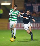 20th September 2017, Dens Park, Dundee, Scotland; Scottish League Cup Quarter-final, Dundee v Celtic; Celtic's Nir Bitton and Dundee's Cammy Kerr