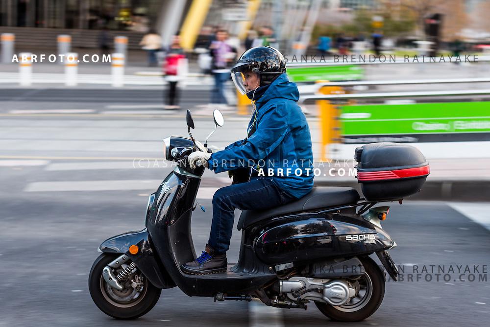 A person riding a scooter Melbourne Victoria Australia