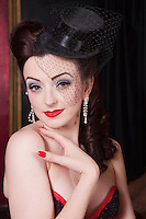 Showgirl with miniature hat portrait