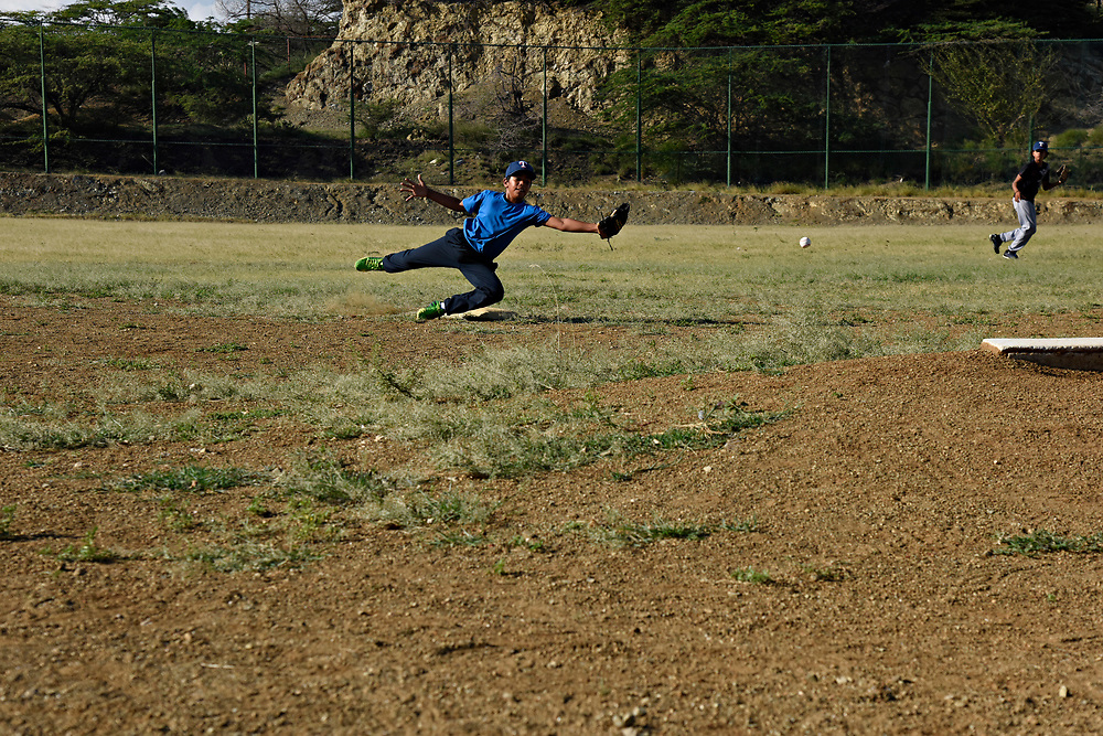WILLEMSTAD, CURACAO - DECEMBER 11, 2014: Many people attribute the good shortstops that Curacao produces to the crummy fields they learn on, where bad bounces are the norm. Here, Euris Annastacia, 10, learns to field for his Marchena Hardware team at Parke Shon Ki Nicasia in Willemstad. (photo by Melissa Lyttle)
