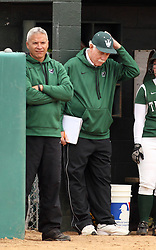 30 March 2013:  Titan Coaches Graham Arnold and Lyle Day during an NCAA Division III women's softball game between the DePauw Tigers and the Illinois Wesleyan Titans in Bloomington IL