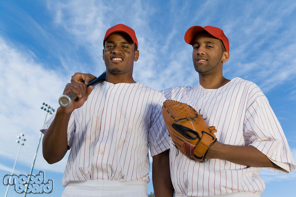 Baseball team mates outdoors (portrait)
