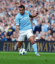 : Carlos Tevez of Manchester City in action during the Barclays Premier League match between Manchester City and Chelsea at the City of Manchester Stadium on September 25, 2010 in Manchester, England.