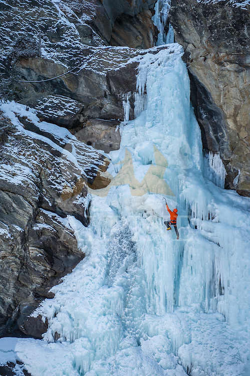 Jeff Mercier, a professional ice climber as seen ascending the classical Cascatte di Lillaz icefall in Cogne, Italy.