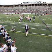 Will Mangan #21 of the Boston Cannons runs onto the field prior to the game at Harvard Stadium on May 10, 2014 in Boston, Massachusetts. (Photo by Elan Kawesch)