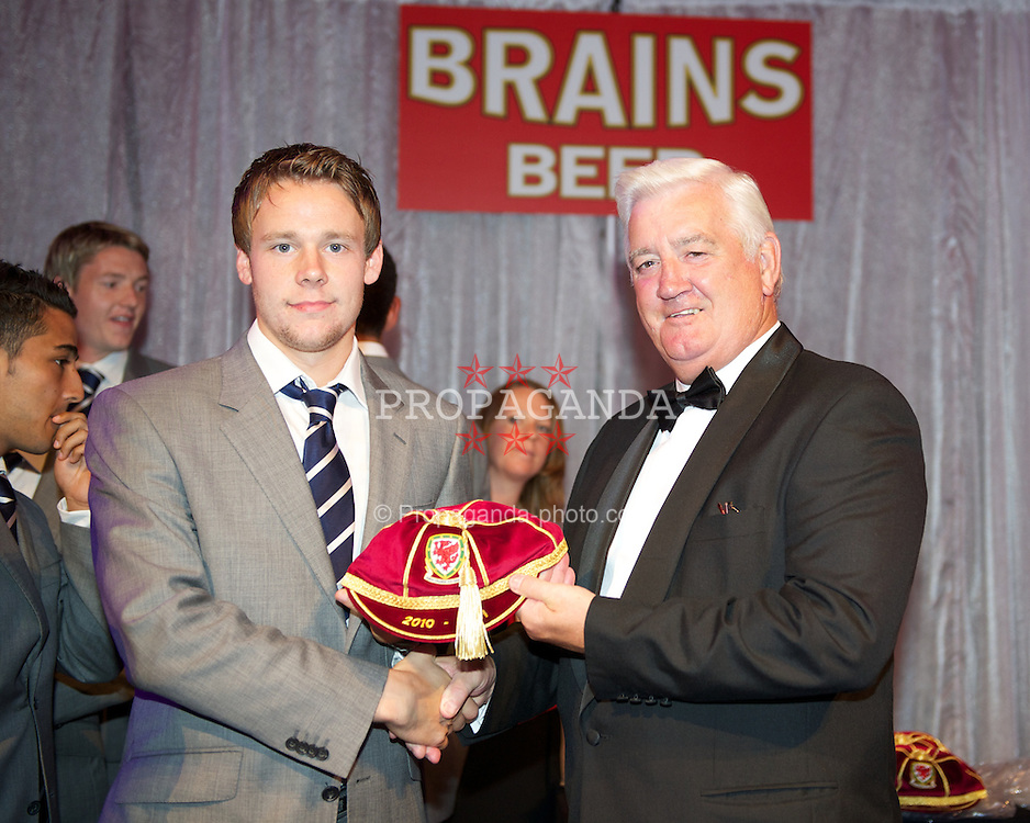 CARDIFF, WALES - Tuesday, October 4, 2011: Wales' Chris Gunter is presented with his national team cap by FAW President Phil Pritchard at the FAW Footballer of the Year Awards 2011 held at the Wales National Museum. (Pic by David Rawcliffe/Propaganda)