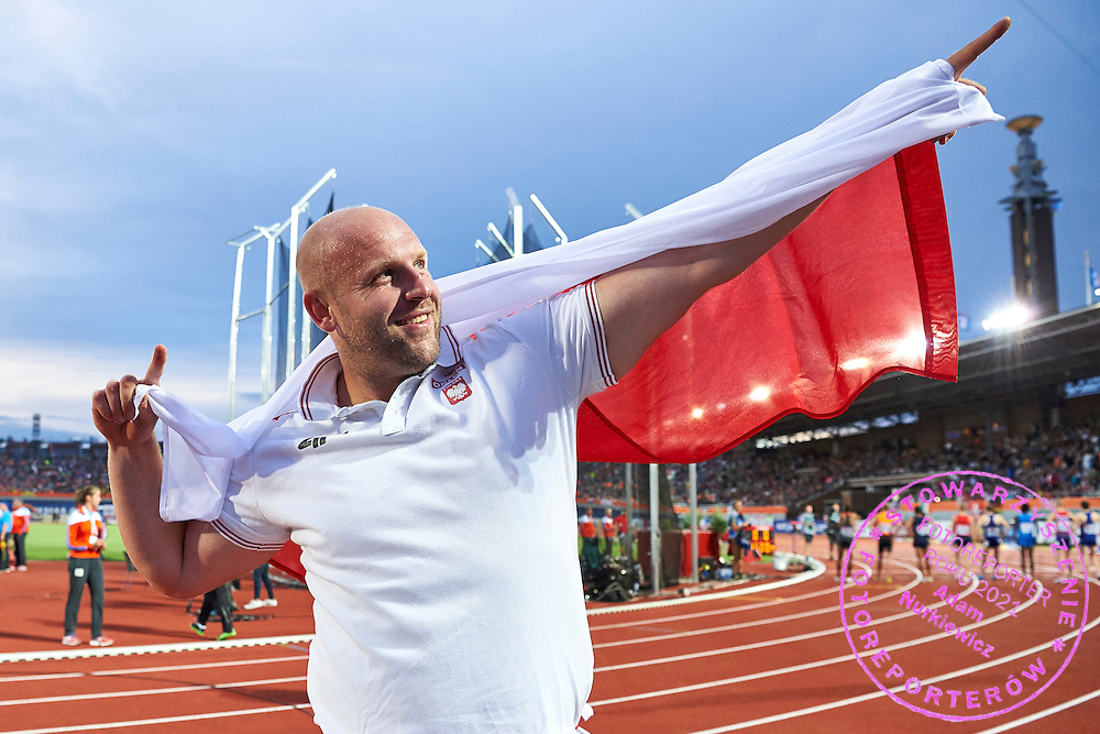 Amsterdam, Netherlands - 2016 July 09: Piotr Malachowski (WKS Slask Wroclaw) from Poland poses with flag and celebrates his victory in men&rsquo;s discus  final during European Championships Athletics 2016 at Olympic Stadium on July 09, 2016 in Amsterdam, Netherlands.<br /> <br /> Adam Nurkiewicz declares that he has no rights to the image of people at the photographs of his authorship.<br /> <br /> Picture also available in RAW (NEF) or TIFF format on special request.<br /> <br /> Any editorial, commercial or promotional use requires written permission from the author of image.<br /> <br /> Mandatory credit:<br /> Photo by &copy; Adam Nurkiewicz