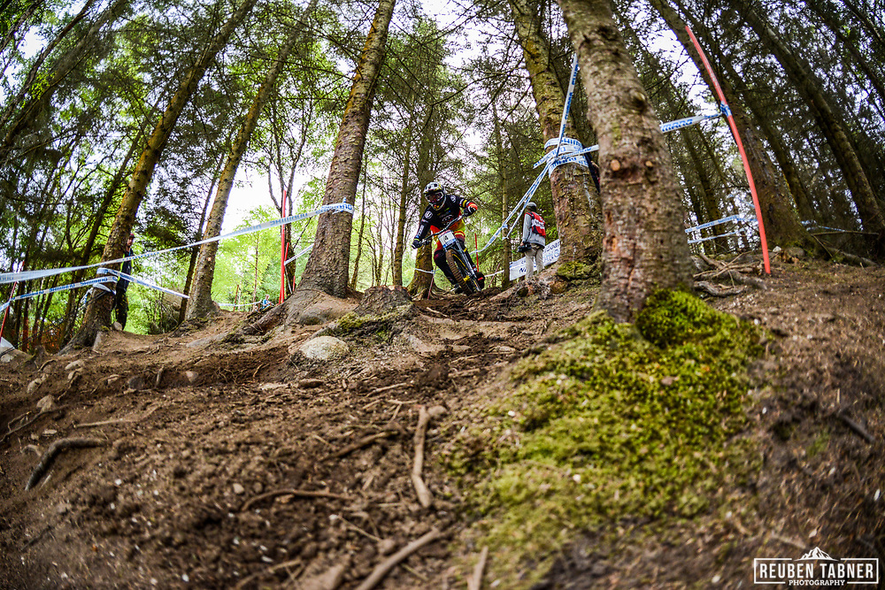 Florent Payet works out a way through the trees during his practise run at the Fort William Mountain Bike World Cup.