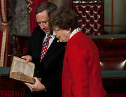 Nov 29, 2010 - Washington, District of Columbia, U.S. - Sen.-Elect MARK KIRK, (R-IL) looks at an old Navy bible with his mother JUDY KIRK on Monday, before a re-enactment of his swearing-in ceremony at the Old Senate Chamber in the U.S. Capitol..(Credit Image: © Pete Marovich/ZUMA Press)