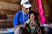 Wesley spends time with a baby boy whose mother has died from AIDS.  Wesley makes home visits to check up on his friends' condition and he also brings them nutritious food.