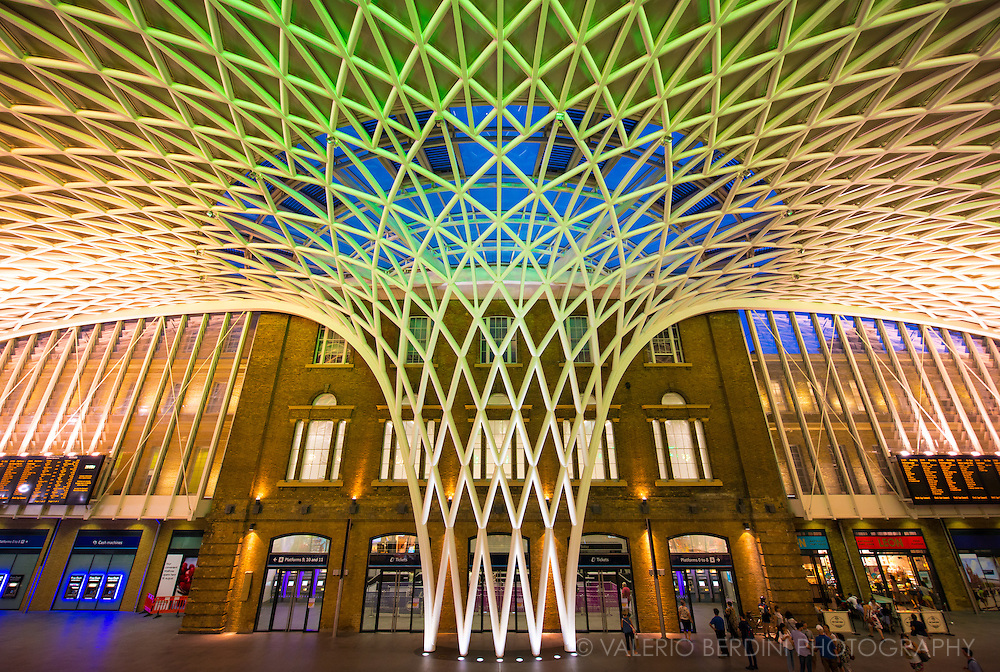 King's Cross railway station is a major London railway terminus, opened in 1852. A new semi-circular departures concourse, opened to the public on 19 March 2012. Designed by John McAslan and built by Vinci, the architect claims that the roof is the longest single-span station structure in Europe. The semi-circular building has a radius of 54 metres and over 2000 triangular roof panels, half of which are glass.