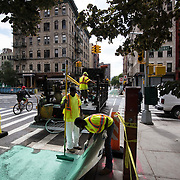 September 22, 2015 - New York, NY : <br /> New York City transportation officials gathered on Clinton Street between Grand St. and East Broadway on Tuesday morning, where they held a press conference to announce the completion of a newly installed protected bike lane, and to celebrate the city surpassing 1,000-miles of designated bike lanes. Here, a DOT crew works on Clinton Street, north of East Broadway, to complete the new protected bike lane.<br /> CREDIT: Karsten Moran for The New York TImes