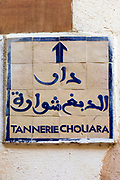 FEZ, MOROCCO - 1ST DECEMBER 2016 - Sign directing people to the Chouwara Tannery in the old Fez Medina, Middle Atlas Mountains, Morocco.