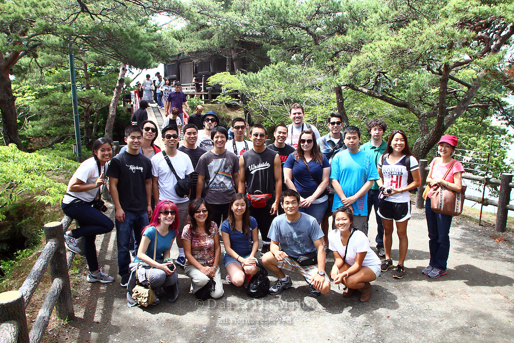 "June 20, 2012; Matsushima, Miyagi Pref., JPN - Tohoku recovery. ..Students on the Terasaki Foundation Japan Educational Tour pose for a group photo in Matsushima...The Bishamondo (the shrine of a Buddhist god) was erected on the occasion of Sakanoueno Tamuramaro's (758-811 A.D.) expedition to the East, and the ""Godaido Hall"", a symbol of Matsushima, was named after the Godai Myoo (the Five Great Vidyarajas) enshrined on the occasion of the establishment of the Zuiganji Temple by the Great Monk Jikaku (794-864 A.D.). The current building was reconstructed by lord Date Masamune, utilizing all possible methods of the Momoyama Architectural Style. According to the legend, when the Great Monk Jikaku enshrined the Five Great Vidyarajas, the Bishamonten (a god of Buddhism) dedicated by the Sakanoueno Tamuramaro, flew away to one of the offshore islands beaming lights. The island Bishamonten landed on is now called Bishamonto Island."