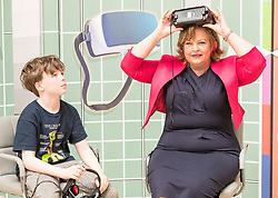 Cabinet Secretary for Culture, Tourism and External Affairs, Fiona Hyslop visits one of the highlights of the annual Edinburgh International Science Festival, Play On at the National Museum of Scotland. Play On is a family-friendly, interactive exhibition which is divided into four zones (Game Theory, Make Some Noise, Toy Box and Picture This) and explores how technology influences our leisure time.<br />  <br /> Ms Hyslop met with the Science Festival&rsquo;s Directors, Simon Gage and Amanda Tyndall, as well as the artists and designers behind the Play On.<br /> <br /> Pictured: Fiona Hyslop using a Virtual Reality headset with Ben Burnet (Aged 10)