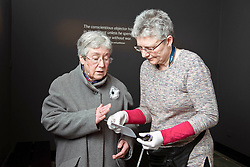 A new exhibition, Conscience Matters, opened at the National War Museum in Edinburgh today. Friday 8 March, exploring the little-known story of British conscientious objectors of the Second World War. The exhibition explores some of the reasons people have refused to take up arms during war and how such refusals are perceived by society. <br /> Pictured: Alison Burnley the 80-year-old daughter of Peter Tennant one of the people whose story features in the exhibition, shares a personal artefact with exhibition curator Dorothy Kidd. © Jon Davey/ EEm