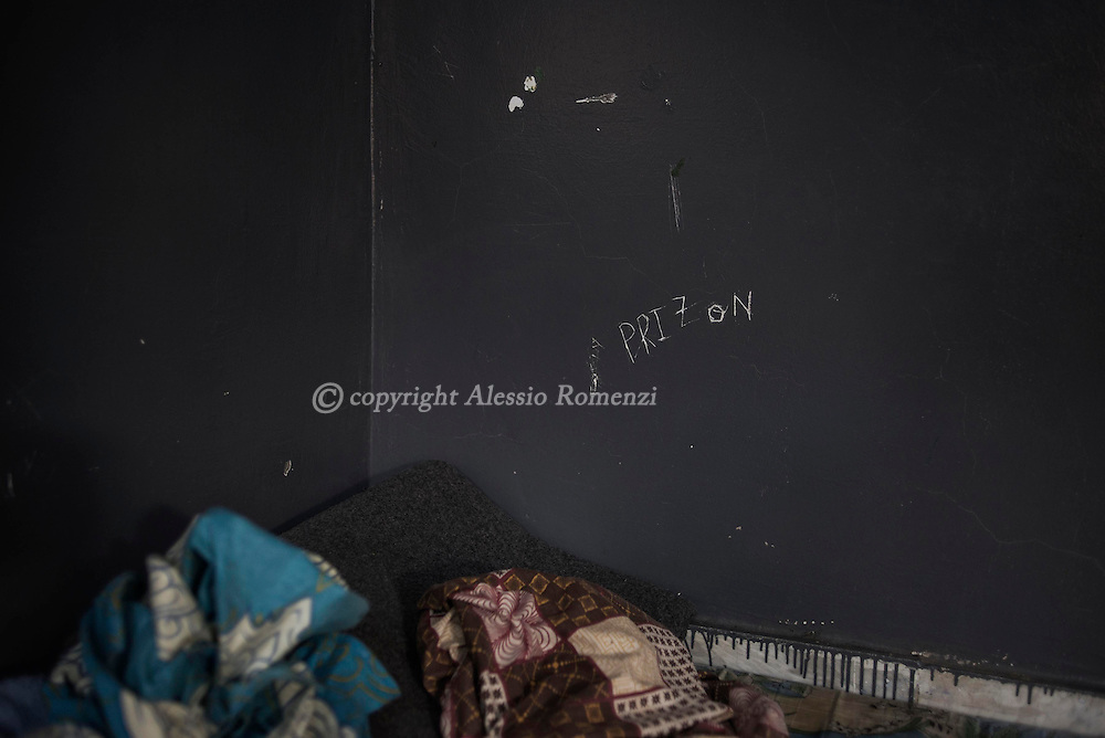 Libya, Garabulli: Graffiti made inside cells of Alguaiha detention by migrants captured at the sea as they were attempting to reach Italy, on May 12, 2015. Alessio Romenzi