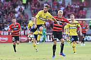 February 12, 2017: Central Coast Mariners midfielder Blake POWELL (6) and Western Sydney Wanderers midfielder Mitch NICHOLS (6) fight for the ball at Round 19 of the 2017 Hyundai A-League match, between Western Sydney Wanderers and Central Coast Mariners played at Spotless Stadium in Sydney.