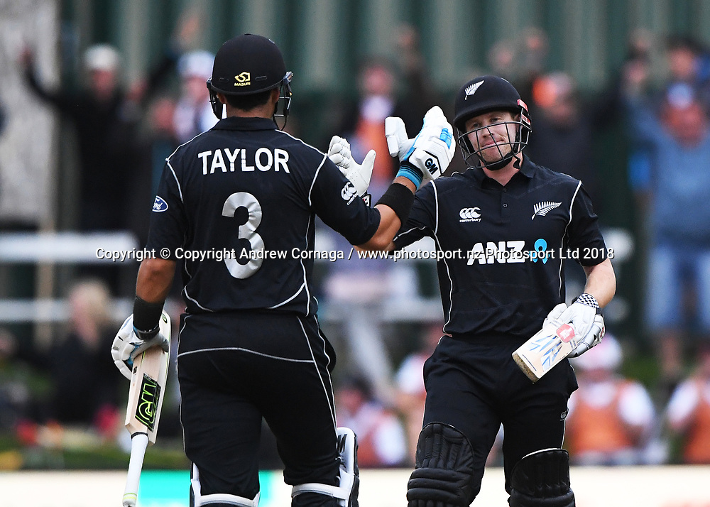 Henry Nicholls and Ross Taylor at the end of winning the match.<br /> New Zealand Black Caps v England, ODI series, University Oval in Dunedin, New Zealand. Wednesday 7 March 2018. &copy; Copyright Photo: Andrew Cornaga / www.Photosport.nz