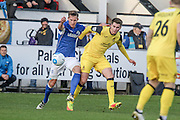 Eastleigh FC Defender Joe Partington and Southport FC Midfielder Liam Nolan battle during the Vanarama National League match between Southport and Eastleigh at the Merseyrail Community Stadium, Southport, United Kingdom on 17 December 2016. Photo by Pete Burns.