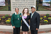 Ohio University President, Roderick McDavis, and Ohio University First Lady, Deborah McDavis, pose with Jeanie McGarvey, a member of Ohio University's Homecoming Court, at the College Gateway on October 8, 2016.
