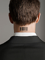 Young man with bar code tattoo on his neck back view