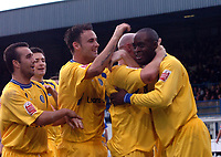 Photo: Paul Greenwood.<br />Bury FC v Wycombe Wanderers. Coca Cola League 2. 17/02/2006. Wycombe's Leon Crooks, right, hugs scorer Tommy Mooney, second right, as team mates run into congratulate him