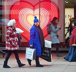 © Licensed to London News Pictures. 23/11/2018. LONDON, UK.  Shoppers in Oxford Street on Black Friday. In this picture: John Lewis window display.  Photo credit: Cliff Hide/LNP