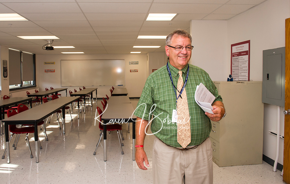 Marc Corriveau will greet his calculus students in their newly renovated classroom within the Math Wing at Laconia High School.  (Karen Bobotas/for the Laconia Daily Sun)