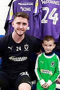 mascot, AFC Wimbledon goalkeeper Joe McDonnell (24)during the EFL Sky Bet League 1 match between AFC Wimbledon and Blackpool at the Cherry Red Records Stadium, Kingston, England on 29 December 2018.