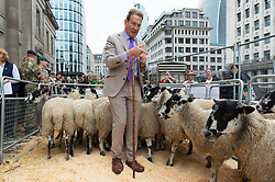 © Licensed to London News Pictures. 29/09/2019. London, UK. Broadcaster Michael Portillo poses with a flock of North of England Mules on London Bridge. The British tradition dating hundreds of years sees Freeman of the City of London take up their historic entitlement to drive their sheep over the bridge whilst raising tens of thousands of pounds for the Lord Mayor's Appeal and the Woolmen's charity. Photo credit: Ray Tang/LNP