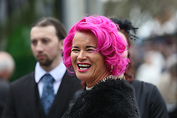 © Licensed to London News Pictures. 09/04/2016. Liverpool, UK. A woman with brightly coloured hair laughs on Grand National day of the Grand National 2016 at Aintree Racecourse near Liverpool. The race, which was first run in 1839, is the most valuable jump race in Europe. Photo credit : Ian Hinchliffe/LNP