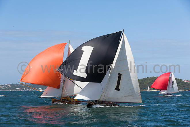 Classic yacht SCOT (left) and TOP WEIGHT during a spinnaker run day 1 of the Historic 18ft Skiff Australian Championship on Sydney Harbour.  22/01/2015 (Photo: Andrea Francolini).