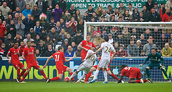SWANSEA, WALES - Sunday, May 1, 2016: Swansea City's Andre Ayew scores the third goal against Liverpool during the Premier League match at the Liberty Stadium. (Pic by David Rawcliffe/Propaganda)