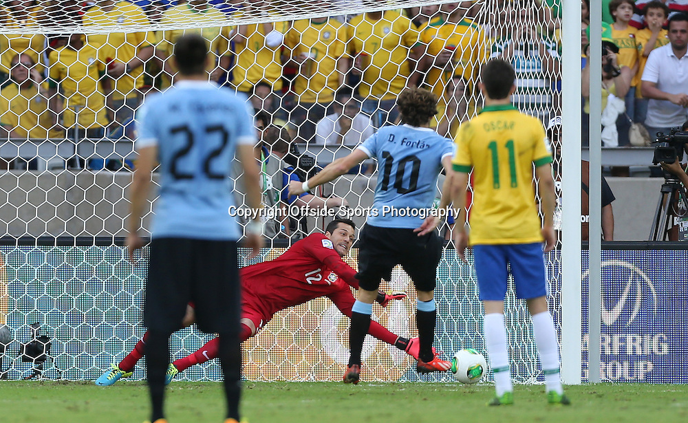 26th June 2013 - FIFA Confederations Cup 2013 (Semi-Final) - Brazil v Uruguay - Brazil goalkeeper Julio Cesar saves a penalty from Diego Forlan of Uruguay - Photo: Simon Stacpoole / Offside.