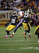 Houston Texans wide receiver DeAndre Hopkins (10) catches a pass for a 32 yard gain as he gets tackled and stripped of the ball by Pittsburgh Steelers free safety Mike Mitchell (23) in the fourth quarter, Pittsburgh Steelers recovered the fumble, during the NFL week 7 regular season football game against the Pittsburgh Steelers on Monday, Oct. 20, 2014 in Pittsburgh. The Steelers won the game 30-23. ©Paul Anthony Spinelli