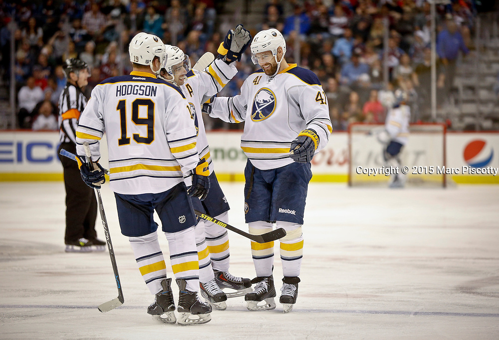 SHOT 3/28/15 8:59:38 PM - Buffalo Sabres teammates Cody Hodgson #19 and Matt Moulson #26 celebrate a goal by Andrej Meszaros #41 during their regular season NHL game against the Colorado Avalanche at the Pepsi Center in Denver, Co. The Avalanche won the game 5-3. (Photo by Marc Piscotty / © 2015)