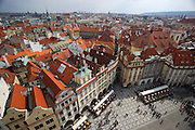 Old Town Square as seen from Town Hall Tower in the heart of Prague, Czech Republic. The square is surrounded by buildings tracing the history of Prague from Gothic, the Renaissance to Baroque.
