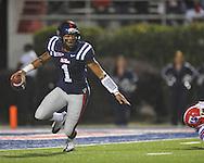 Ole Miss quarterback Randall Mackey (1) eludes Louisiana Tech's Shakeil Lucas (54) in Oxford, Miss. on Saturday, November 12, 2011.