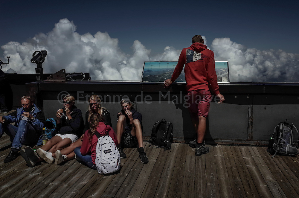Pic de l'Aiguille du Midi. Tourists resting on a terrace. Alt 3,842. 24 July 2016.