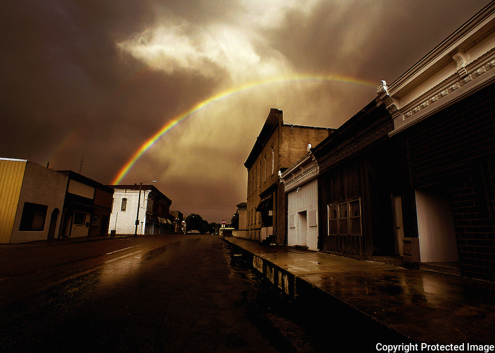 After a gentle spring rain, a rainbow arches over the town of Prairie City, Iowa, a small community 25 miles west of Des Moines. Des Moines, Ia.