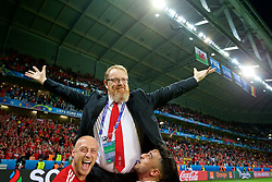 LILLE, FRANCE - Friday, July 1, 2016: Wales' head of international affairs Mark Evans is lifted up by David Cotterill and Neil Taylor as they celebrate after a 3-1 victory over Belgium and reaching the Semi-Final during the UEFA Euro 2016 Championship Quarter-Final match at the Stade Pierre Mauroy. (Pic by David Rawcliffe/Propaganda)